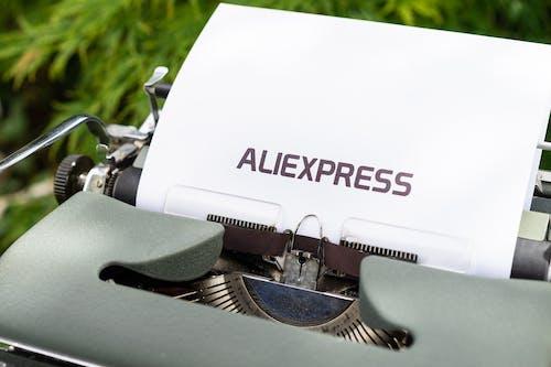 White and Black Typewriter on Green Grass