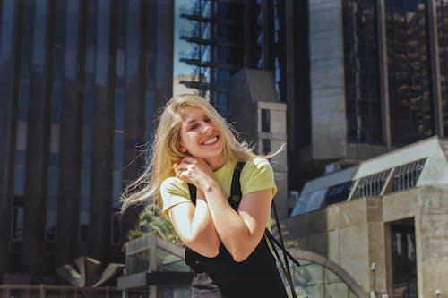 Woman in Black Tank Top Smiling