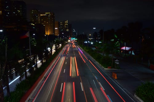 Traffic in modern illuminated city at night