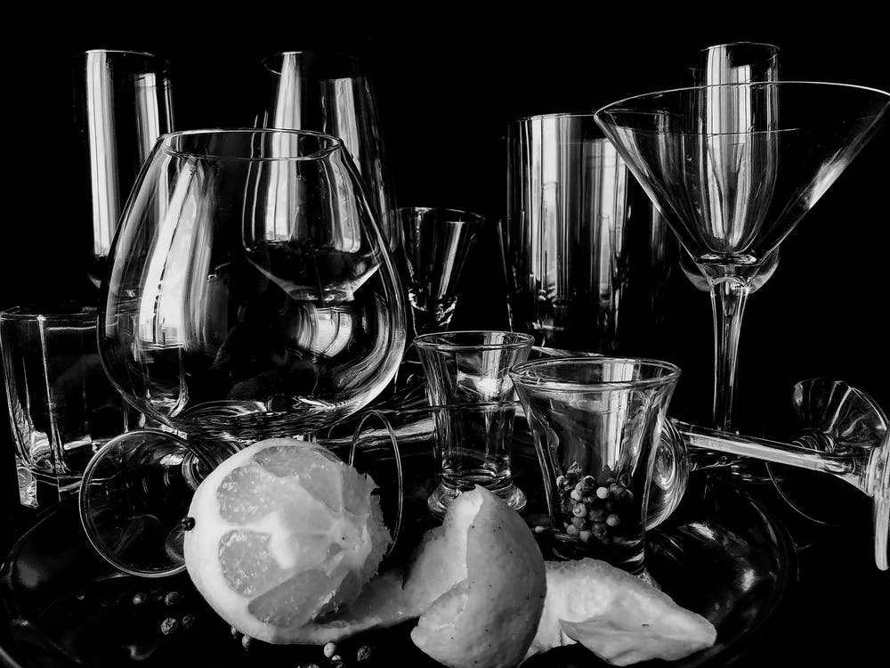 Collection of cocktail glassware placed on table with lemon