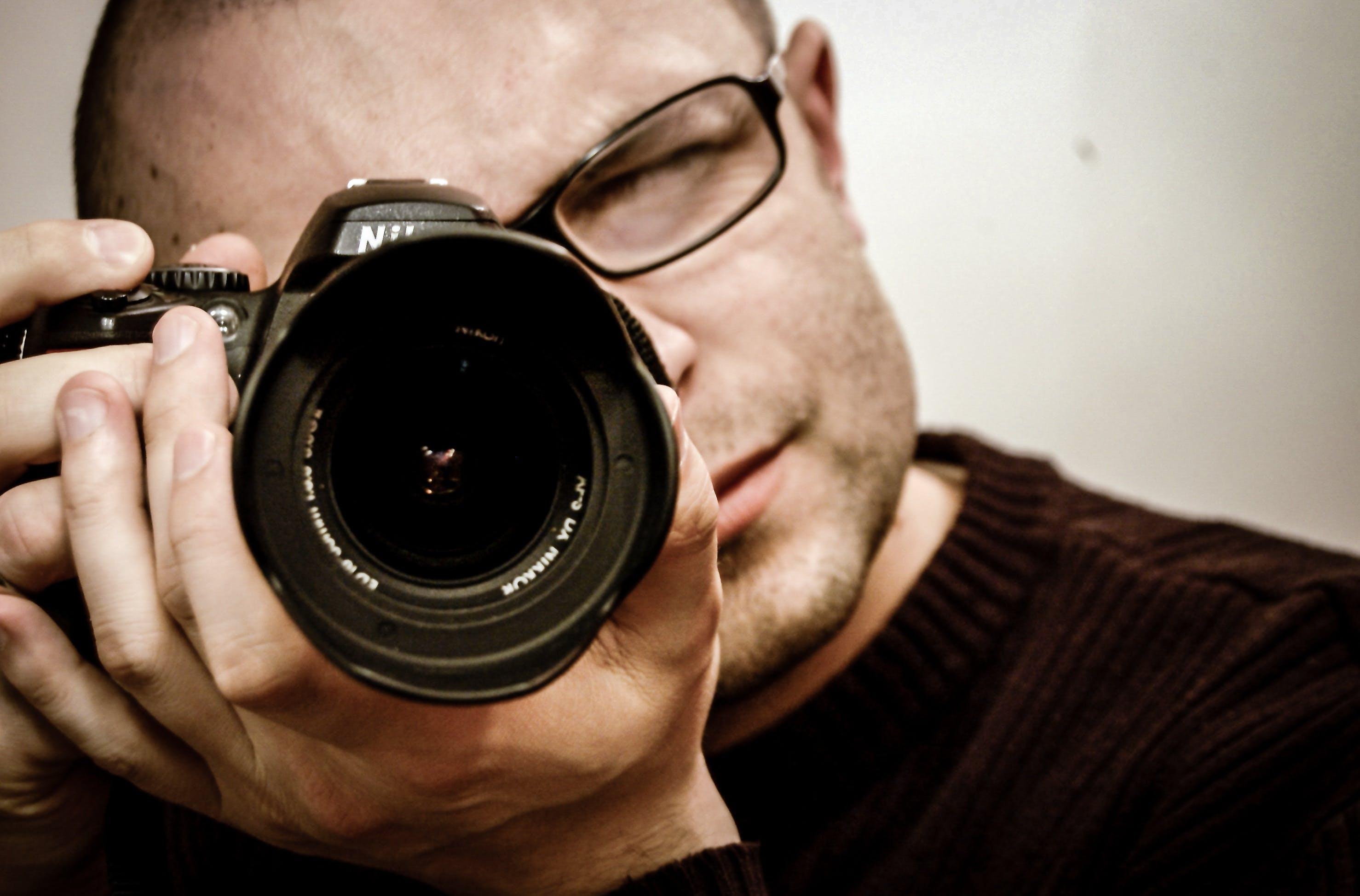 Gratis stockfoto met camera, cameralens, een foto nemen, elektronische apparatuur