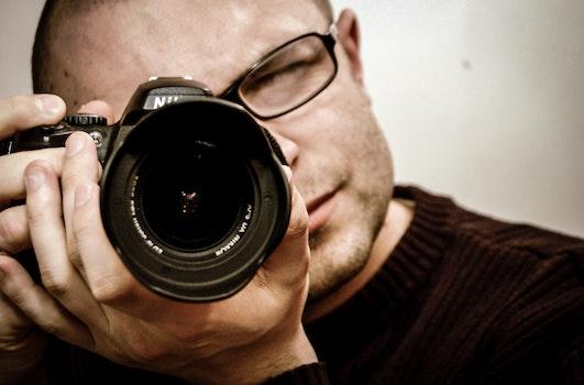 Free stock photo of man, camera, taking photo, photographer