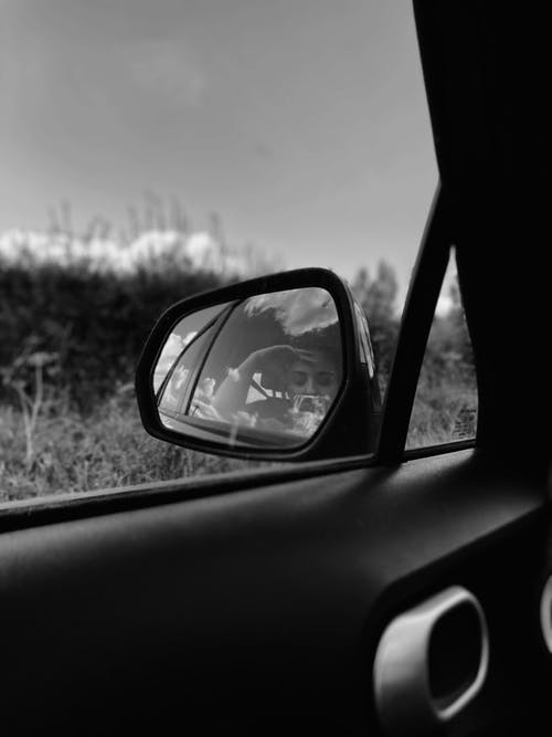 Reflection in side view mirror of car