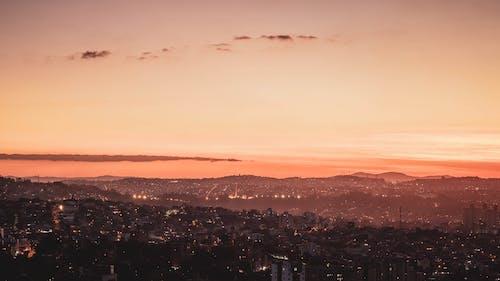 City Skyline Under Orange Sky during Sunset