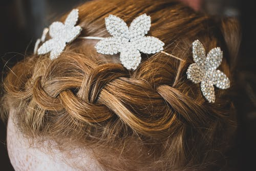 Brown Hair With White Flower Accent