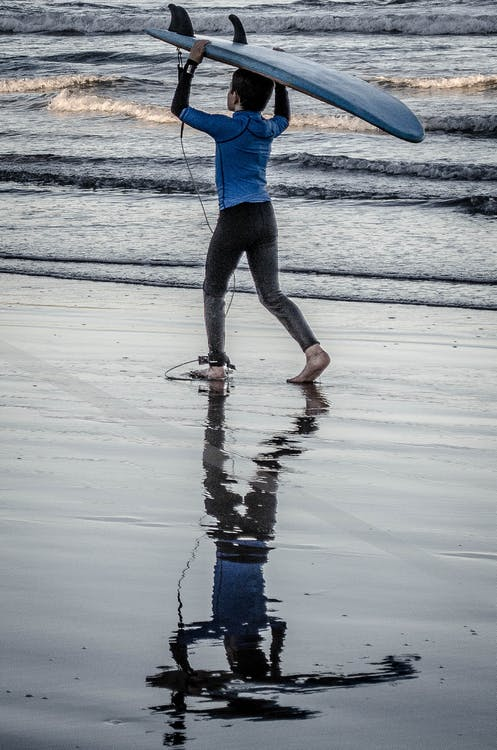 Boy Holding Blue Surfing Board