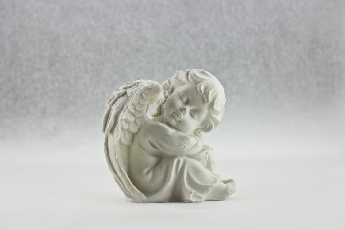 White Angel Sitting Figurine