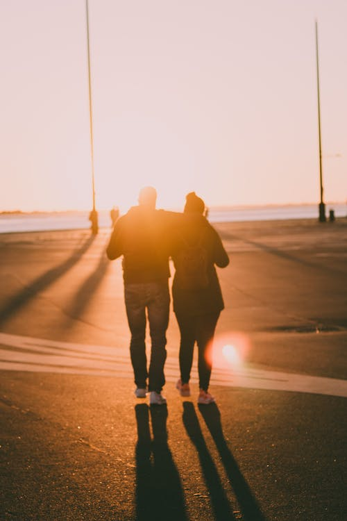 Free stock photo of against the sun, couple, couple hugging, couple walking