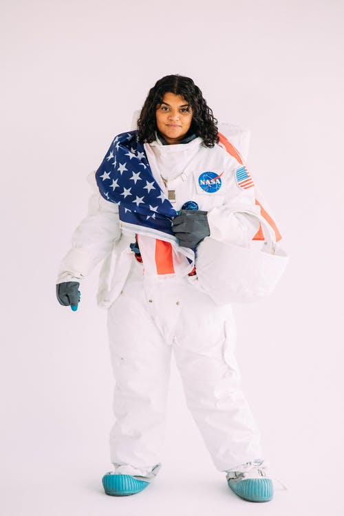 Woman In A White Astronaut Costume
