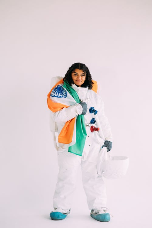 Woman Wearing An Astronaut Costume Holding A Flag