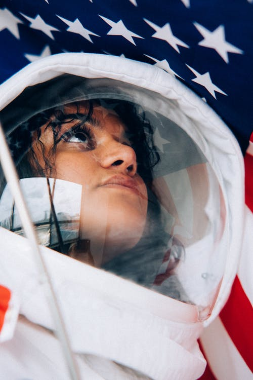 Close-Up Shot Of A Woman In A Space Suit