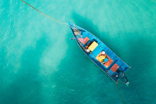 Small boat floating on calm water