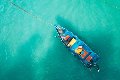 Boat floating on calm turquoise water