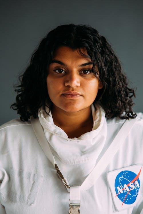 Portrait Photo Of A Woman Wearing A Space Suit