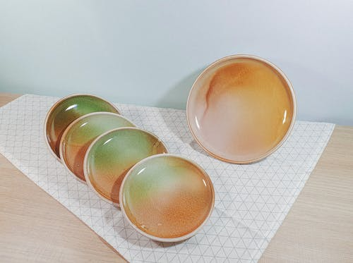 Set of Ceramic Plates on Table