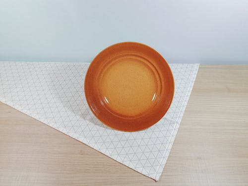 Brown Ceramic Plate on Table