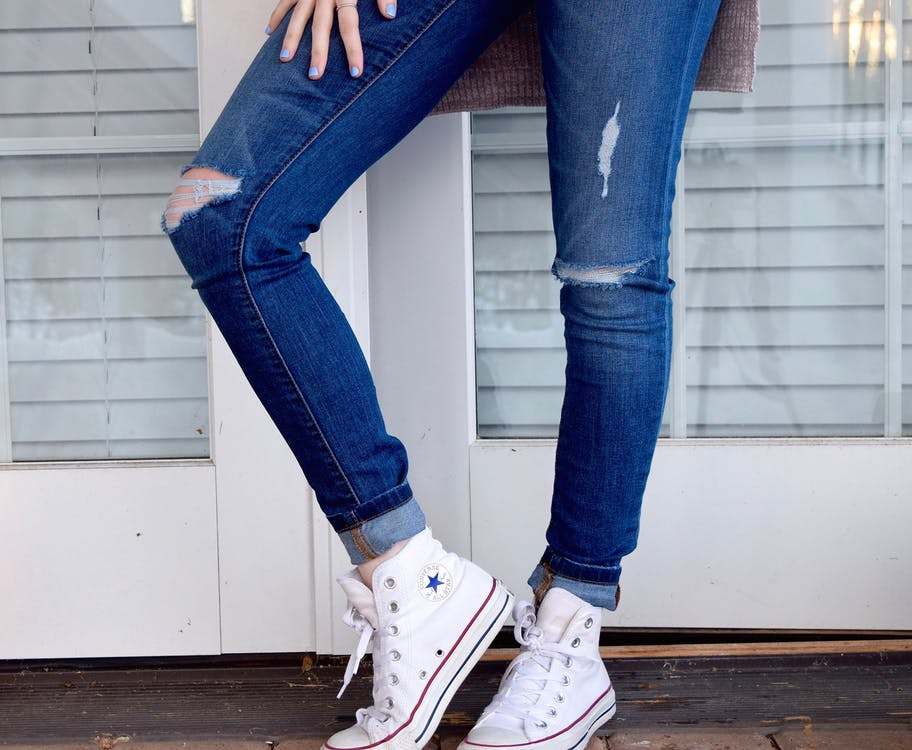 Person in Blue Denim Jeans and White Converse All Stars