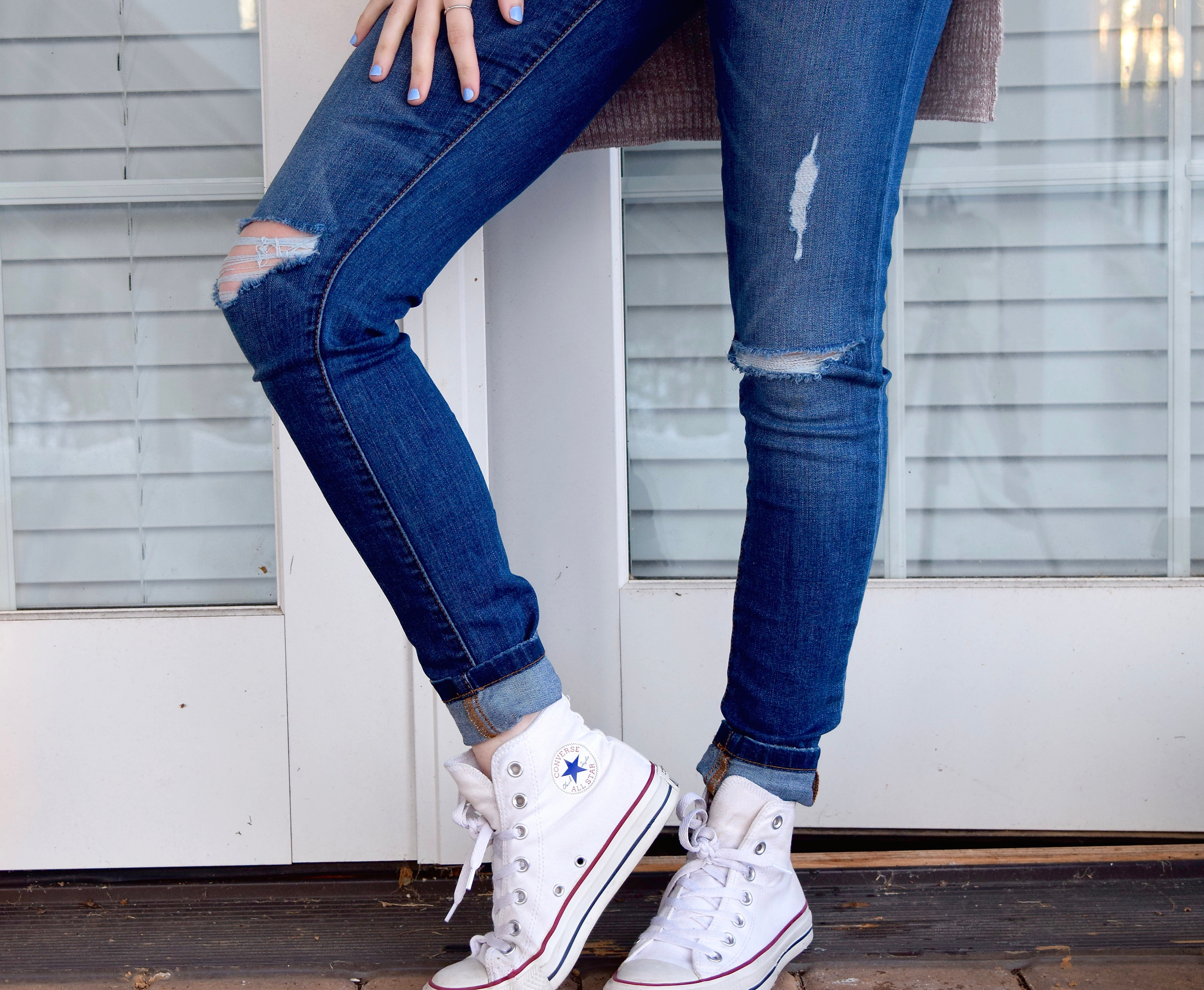 9755faaef3 Person in Blue Denim Jeans and White Converse All Stars · Free Stock ...