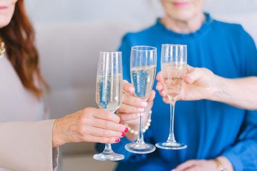 Senior women clinking glasses of champagne