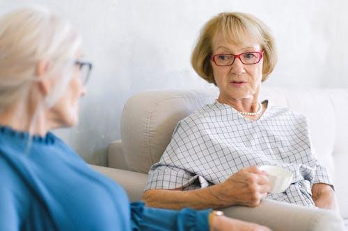 Aged women talking while drinking tea