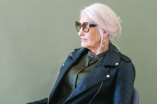 Senior woman in trendy sunglasses in studio