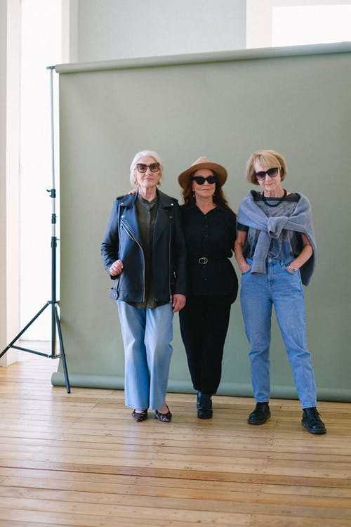 Senior women in trendy outfit in photo studio