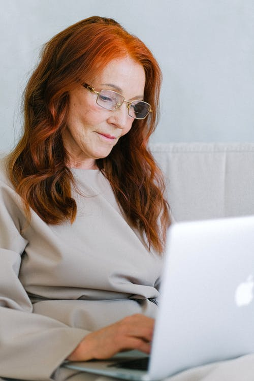 Woman in White Long Sleeve Shirt Wearing Eyeglasses