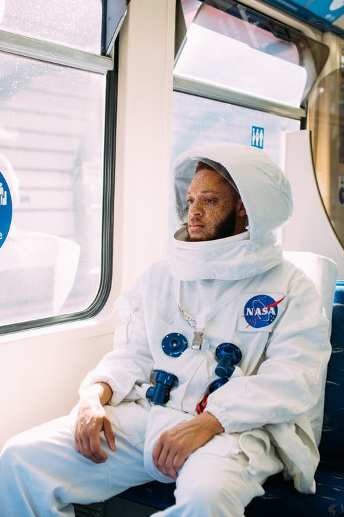 Man In A Space Suit Inside A Train