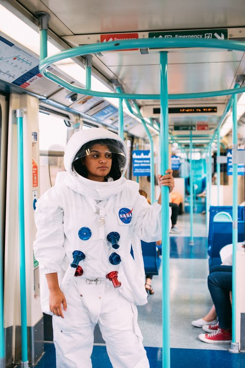 Female Astronaut in Public Transport