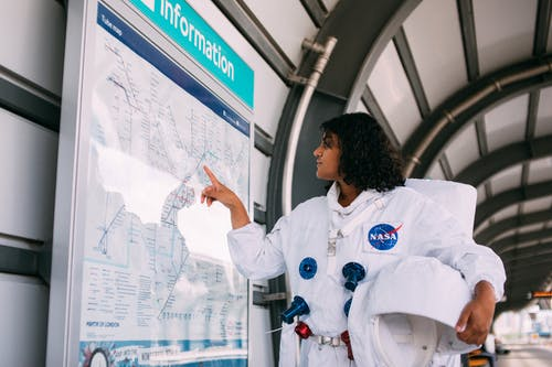 Female Astronaut Looking at a Map