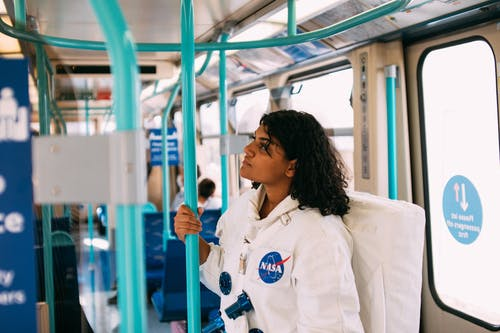 Woman In A Costume Inside A Train