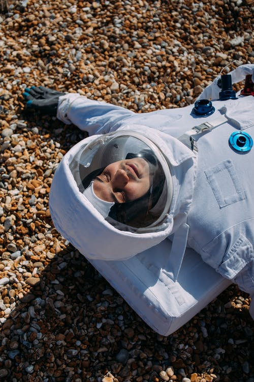 Astronaut Lying on Ground