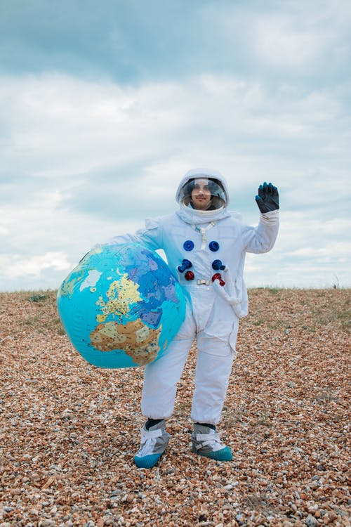 Astronaut With a Planet Earth Ball
