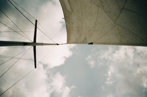 White Wind Turbine Under White Clouds