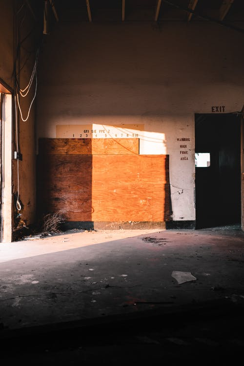 Abandoned building with wooden board