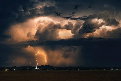 Lightning Strike on Clouds during Night Time