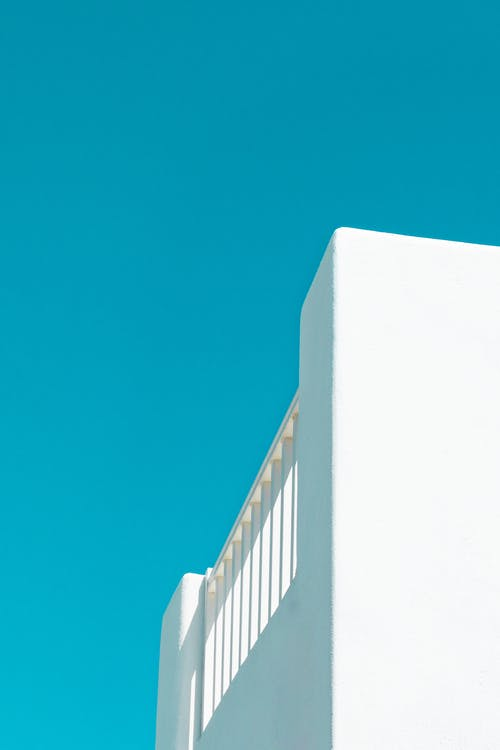Whitewashed Building Under Blue Sky