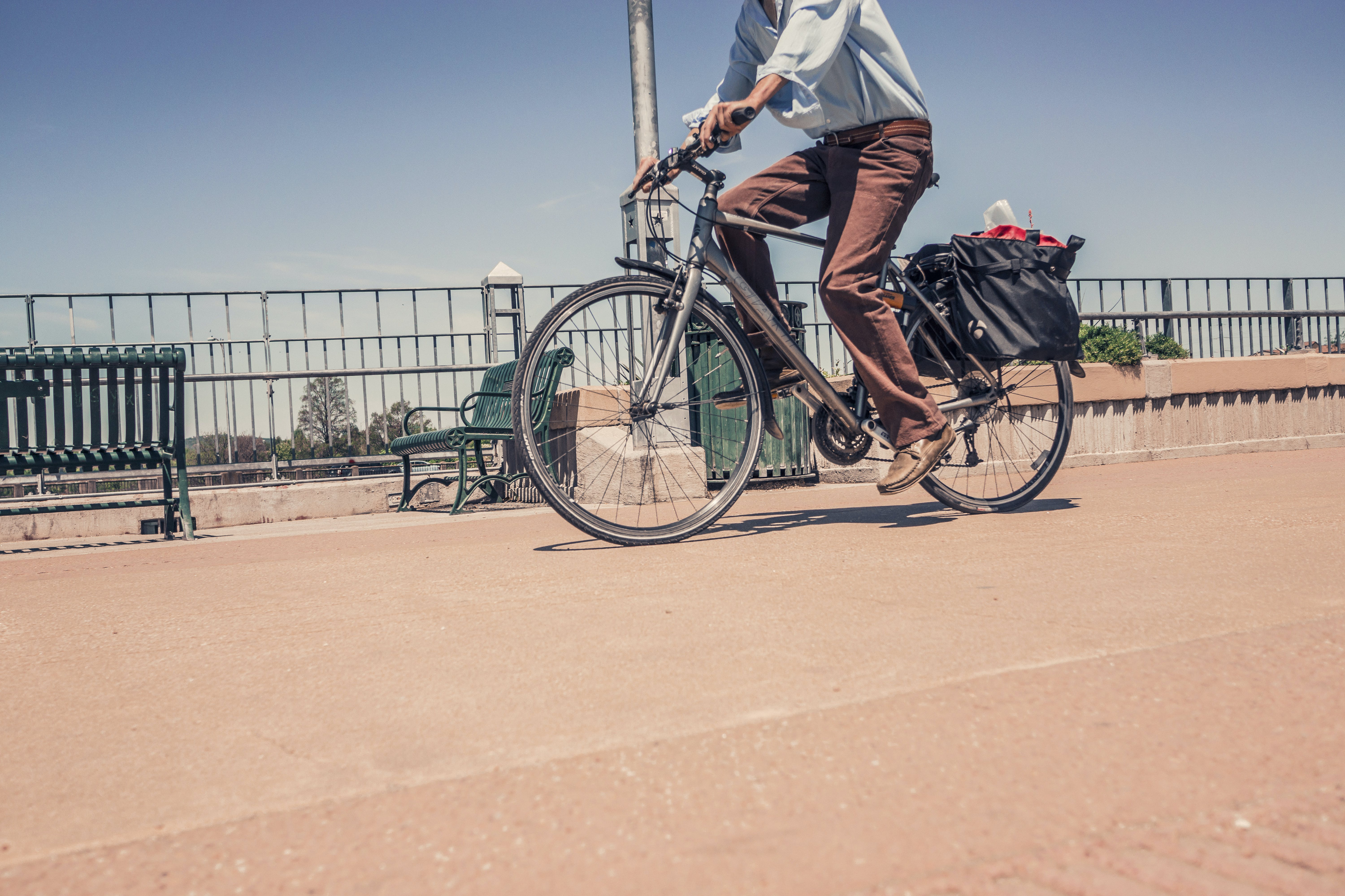 Man Riding Commuter Bike Near Road in Close-up Photography
