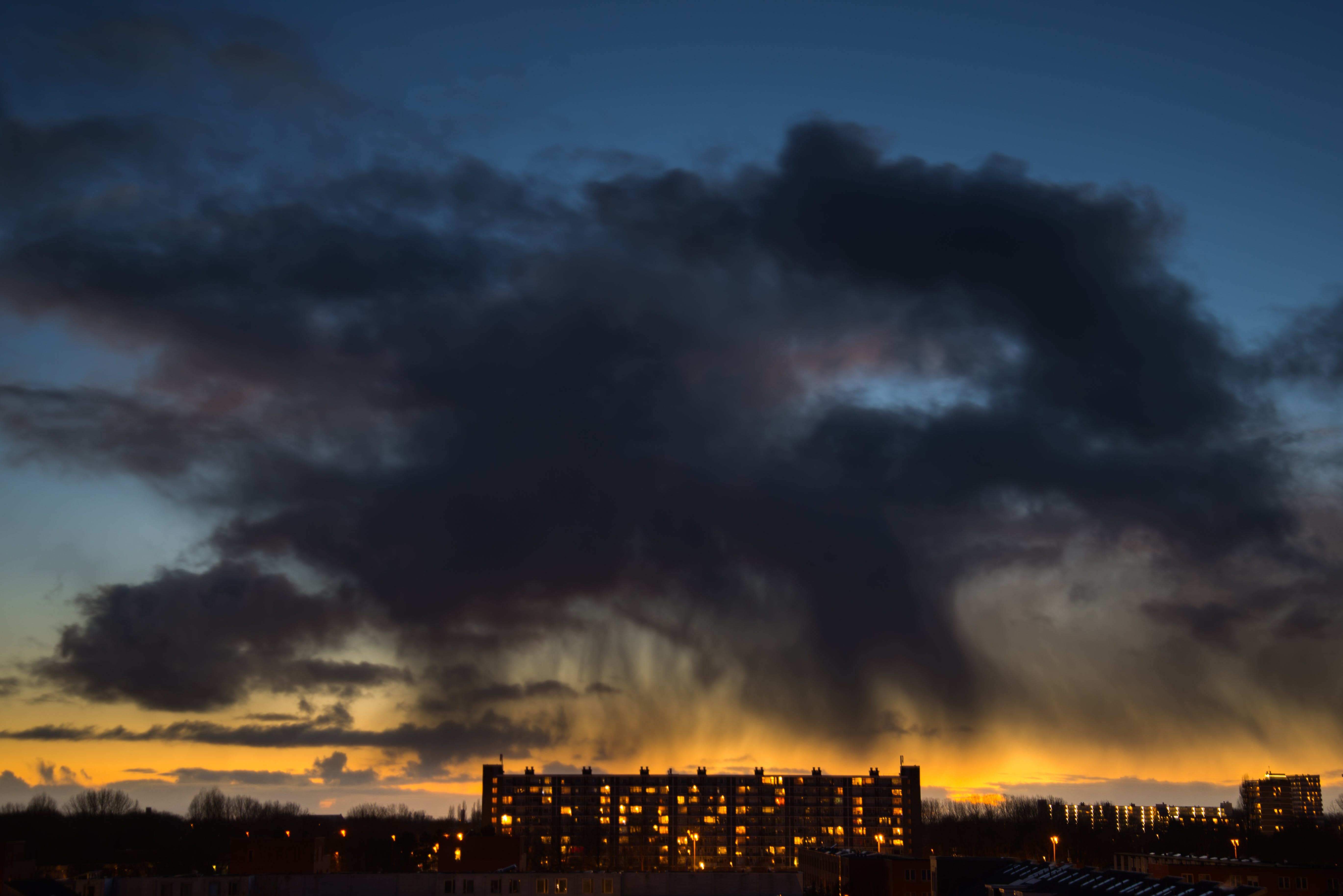 Lighted High Rise Building Under Blue Clouding Sky during Sunset