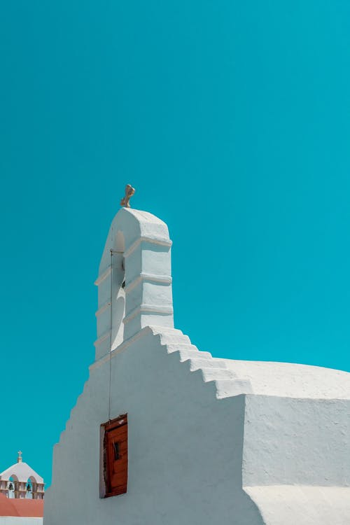 Whitewashed Church Under Blue Sky