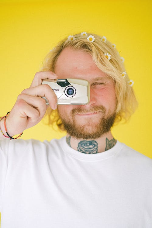 Young man taking photo with camera