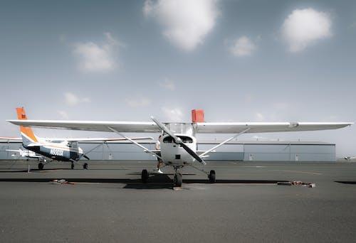 Modern propeller aircraft parked on aerodrome