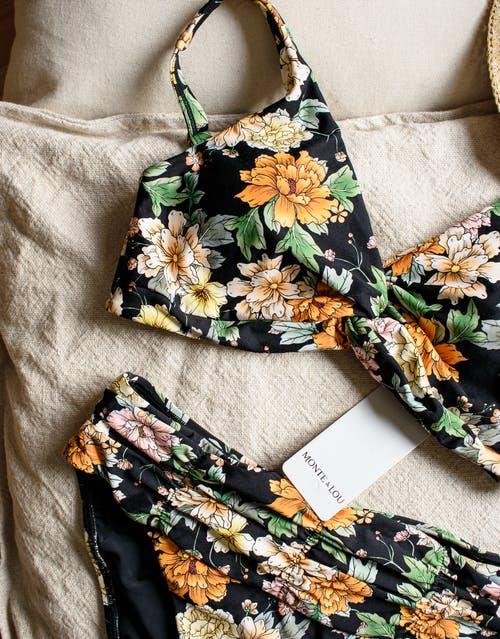 Black White and Orange Floral Textile