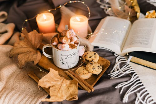 Cookies on White Ceramic Plate Beside White Candle