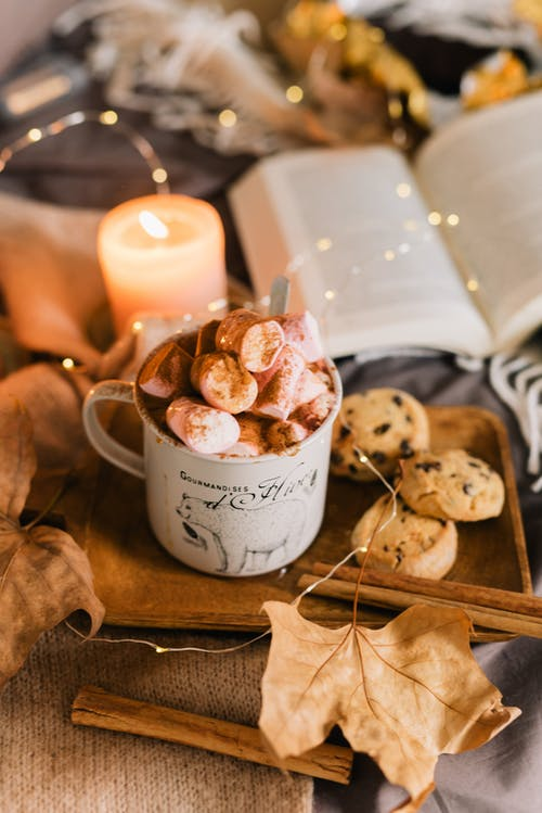 White Ceramic Mug With Cookies on Brown Wooden Table
