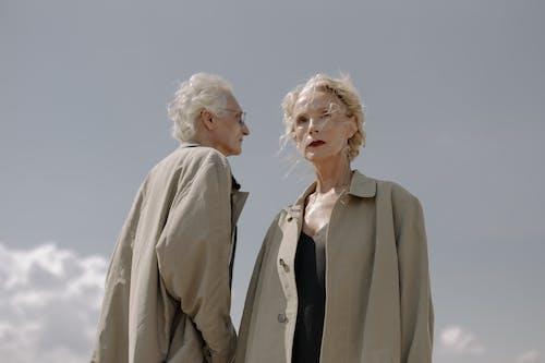 Woman in Gray Coat Standing