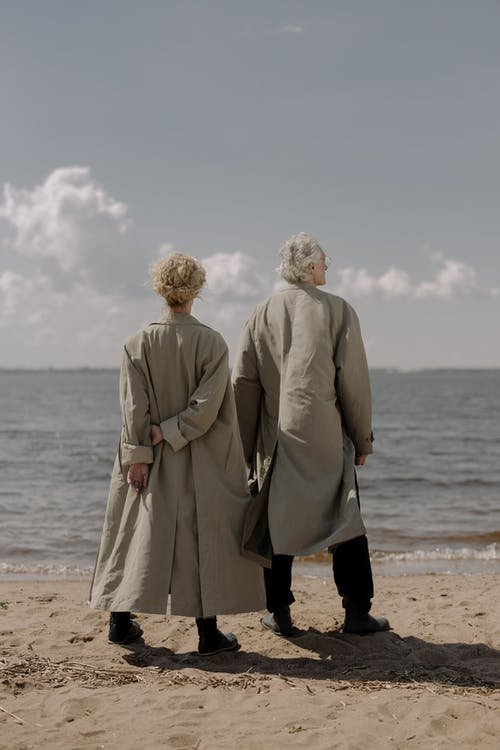 Man and Woman Standing on Beach