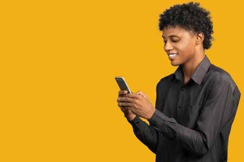 Man in Black Dress Shirt Holding Smartphone