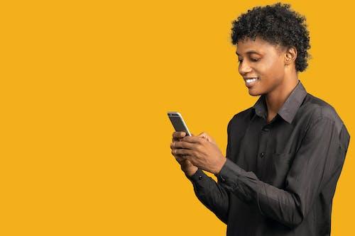 Man in Black Dress Shirt Holding Smartphone