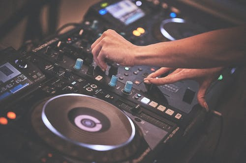 Person Playing Dj Controller With Dj Controller